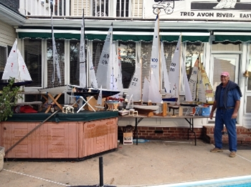 Nick Mortgu with over a dozen RC model yachts