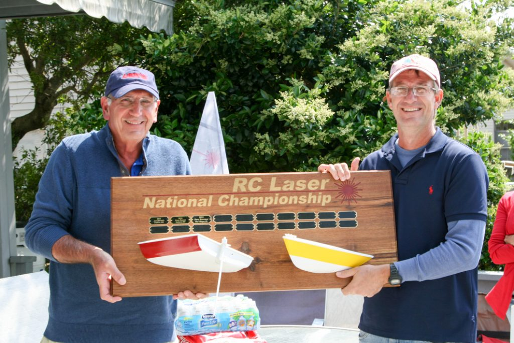 RC Laser Class Secretary Nick Mortgu presents Jim Kaighin with the National Championship trophy
