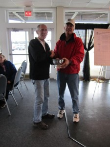 Don Barker, left, accepts Jim Karr Perpetual Trophy from Jim Karr